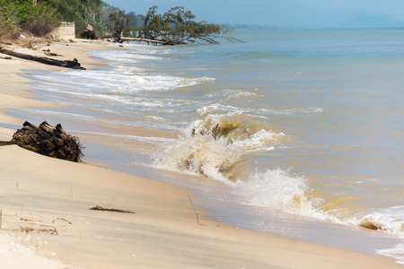 coastal erosion: loss of coastal areas due to erosion of the waves Stock Photo