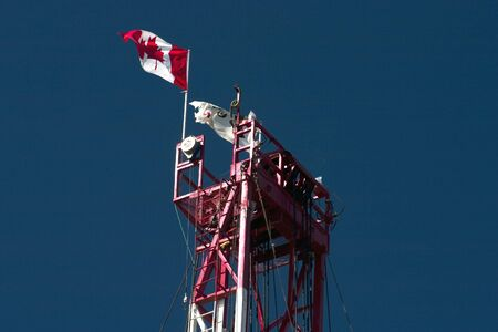 Canadian flag on top of drilling rig. Stock Photo