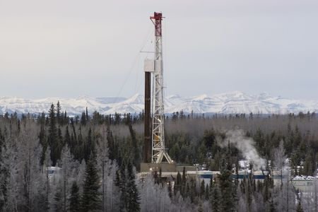 Drillng rig working in the Alberta foothills Stock Photo