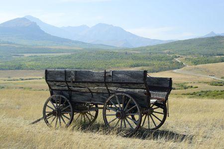 covered wagon: Old wagon on the Alberta prairies.