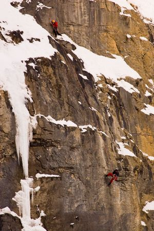 Two climbers on cliff in Banff National Park.