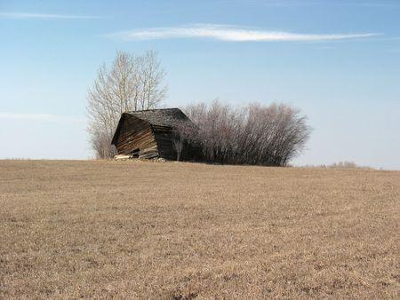 Old house on the prairie, near collapse.