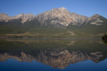 Pyramid Moutain reflected in Pyramid Lake. Stock Photo