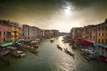 Boats and gondolas on the Grand Canal of Venice, Italy. photo