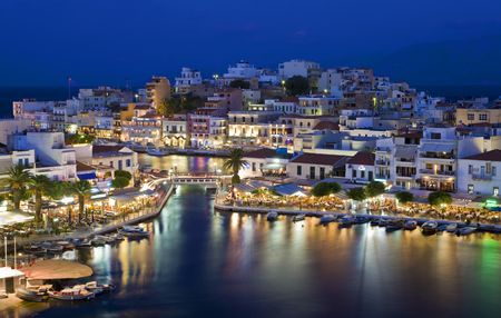 Agios Nikolaos. Agios Nikolaos is a picturesque town in the eastern part of the island built on the northwest side of the peaceful bay of Mirabello.  photo