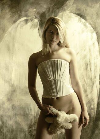 She looks like an angel. Young woman. Working in studio. photo