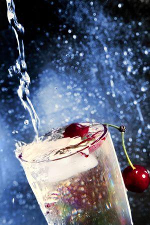 cherry under running water in a glass beaker Stock Photo - 7301580
