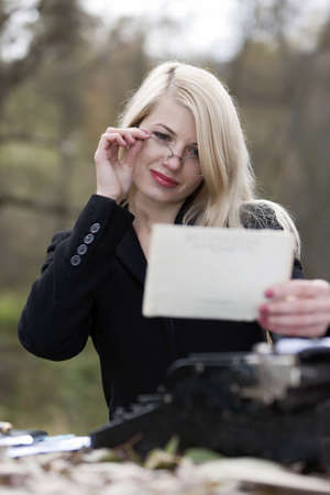 The young sexual secretary does work. Old style. photo