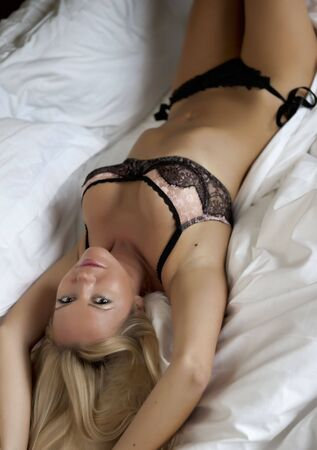 Young sexy woman in bed.