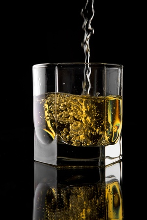 liqueur: Glass of whisky on a black background. Stock Photo