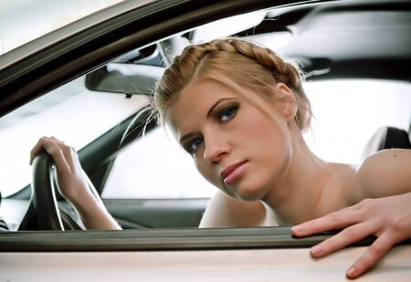 Young sexual blonde in the car. photo