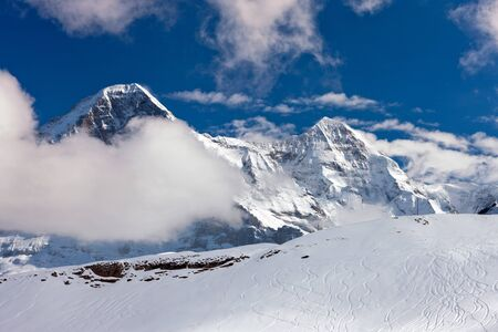 Ski slope in the background of Mount Eiger. The Eiger is a mountain in the Bernese Alps in Switzerland.