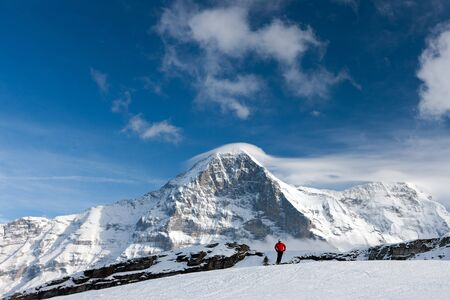 canton berne: Ski slope in the background of Mount Eiger. The Eiger is a mountain in the Bernese Alps in Switzerland.