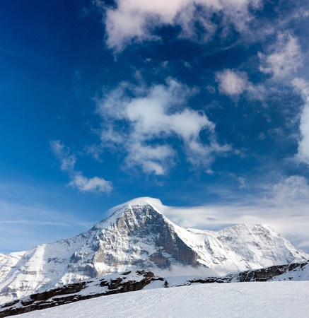 eiger: Ski slope in the background of Mount Eiger. The Eiger is a mountain in the Bernese Alps in Switzerland.