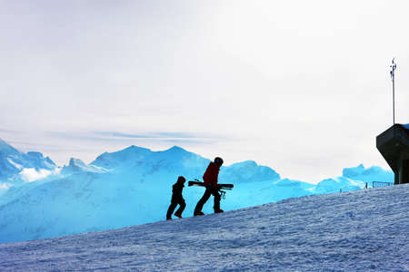 Ski slope. Skiers on the background of the Bernese Alps. photo