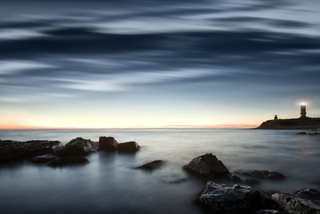 seacoast: Seacoast. A decline. The sky in the light of the moon and the sun. Long exposure, a wide corner. Stock Photo