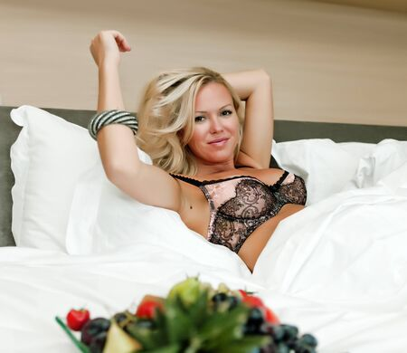 Young sexy woman in bed. Stock Photo - 13006585