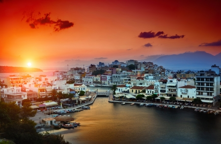 Agios Nikolaos. Agios Nikolaos is a picturesque town in the eastern part of the island Crete built on the northwest side of the peaceful bay of Mirabello. Stock Photo