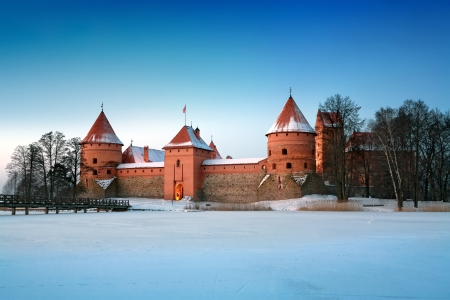 Trakai. Trakai is a historic city and lake resort in Lithuania. It lies 28 km west of Vilnius, the capital of Lithuania.
