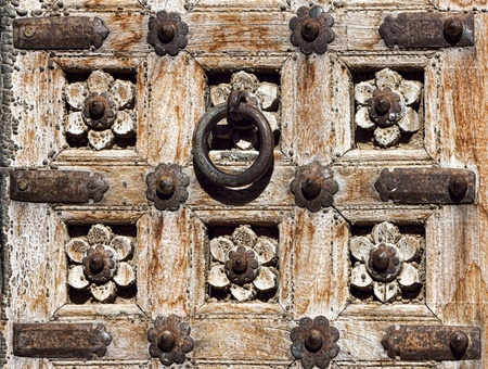 Old wooden door with floral decoration. Fragment. Rajasthan,India photo