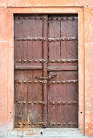 east gate: Old brown wooden door. Rajasthan,India