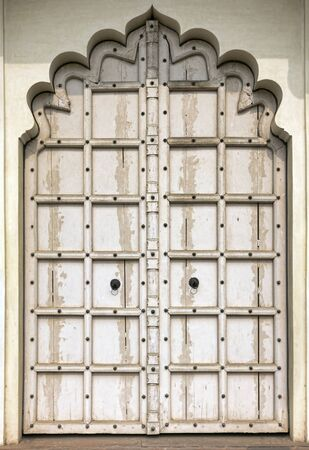 arabic architecture: Old white wooden door. Rajasthan,India