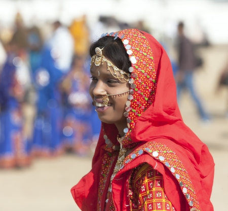 ethnic attire: PUSHKAR, INDIA - NOVEMBER 21:  An unidentified girl in colorful ethnic attire attends at the Pushkar fair on November 21, 2012 in Pushkar, Rajasthan, India.