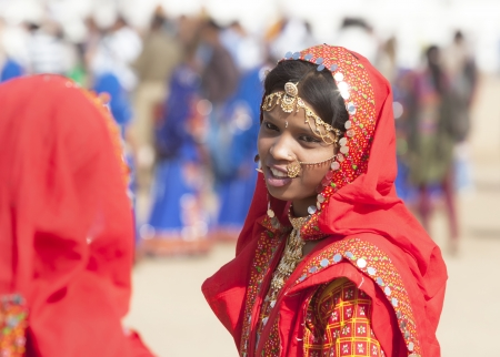 PUSHKAR, INDIA - NOVEMBER 21:  An unidentified girls in colorful ethnic attire attends at the Pushkar fair on November 21, 2012 in Pushkar, Rajasthan, India.