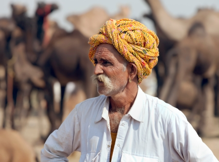 thar: PUSHKAR, INDIA - NOVEMBER 21: An unidentified men attends the Pushkar fair on November 21, 2012 in Pushkar, Rajasthan, India. Farmers and traders from all over Rajasthan flock for the annual fair Editorial