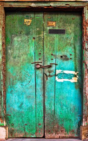 Old dilapidated wooden door. Rajasthan, India photo