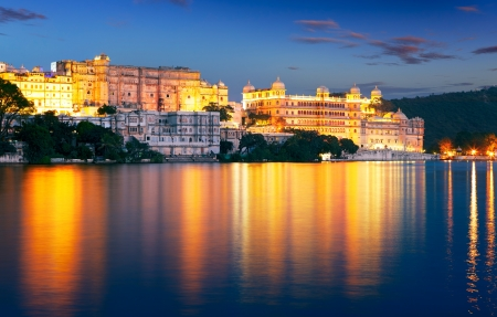 Pichola lake and City Palace at night. Udaipur, Rajasthan, India, Asia