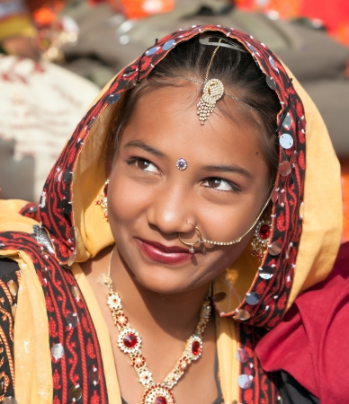 PUSHKAR, INDIA - NOVEMBER 21: An unidentified girl  in colorful ethnic attire attends at the Pushkar fair on November 21, 2012 in Pushkar, Rajasthan, India.