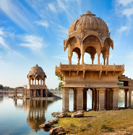 Gadi Sagar (Gadisar) Lake is one of the most important tourist attractions in Jaisalmer, Rajasthan, North India.     Artistically carved temples and shrines around The Lake Gadisar Jaisalmer. photo