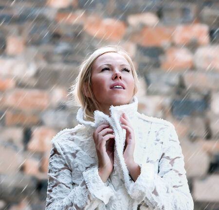 woman under rain photo