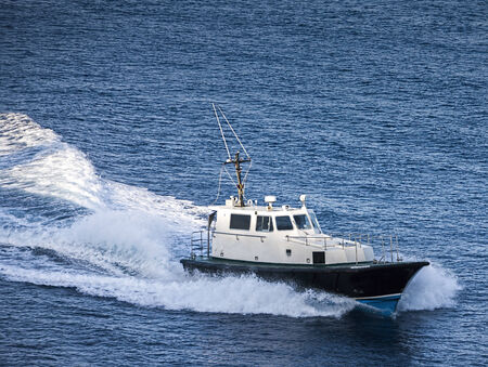 speed boat: Pilot boat in Caribbean sea. Stock Photo