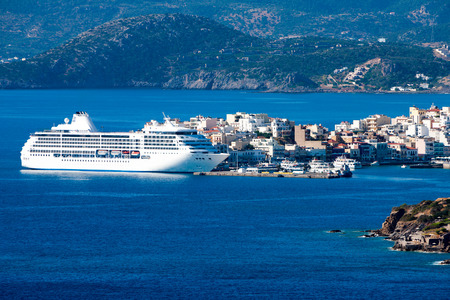 White passenger ship off the coast of Agios Nikolaos. Crete, Greece 免版税图像