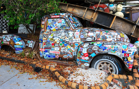 KEY WEST, FLORIDA - OCTOBER 8: Old car covered with a variety of stickers at Bos Fish Wagon restaurant in Key West, Florida, USA