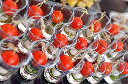 appetizers: Cheese canapes with cherry tomatoes in the glass close up Stock Photo