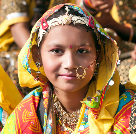 ethnic attire: PUSHKAR, INDIA - NOVEMBER 21: An unidentified girl in colorful ethnic attire attends at the Pushkar fair on November 21, 2012 in Pushkar, Rajasthan, India. Editorial