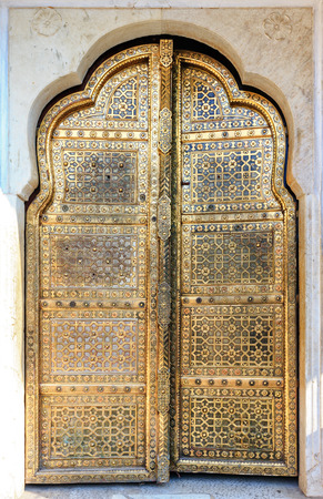 indian culture: Golden Doors of Hawa Mahal or Palace of Winds in Jaipur, Rajasthan, India, Asia