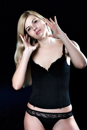 model face: Young blond woman touching her hair