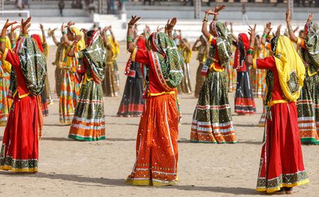 veiled: Indian girls in colorful ethnic attire dancing at Pushkar fair, Pushkar, Rajasthan, India, Asia Editorial