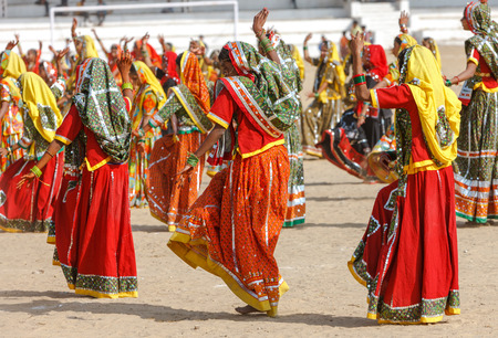 indian fair: Indian girls in colorful ethnic attire dancing at Pushkar fair, Pushkar, Rajasthan, India, Asia Editorial