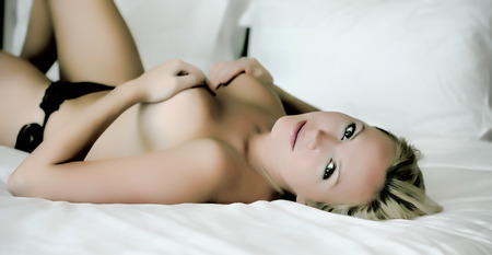 sexy girl nude: Young sexy blond woman on the bed