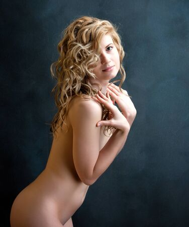 girls naked: Young sexy blond woman with long curly hair