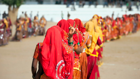 indian fair: Indian girls in colorful ethnic attire dancing at Pushkar fair, Pushkar, Rajasthan, India, Asia Stock Photo