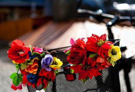 Artificial flowers on a metal bike basket
