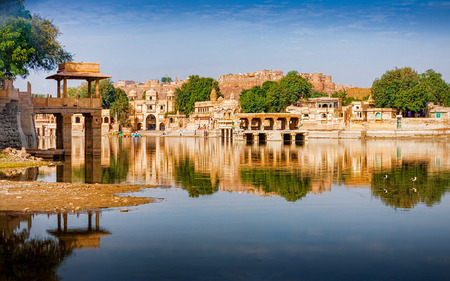 dome of hindu temple: Gadi Sagar (Gadisar) Lake is one of the most important tourist attractions in Jaisalmer, Rajasthan, North India. Artistically carved temples and shrines around The Lake Gadisar Jaisalmer.