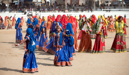 indian fair: PUSHKAR, INDIA - NOVEMBER 21: An unidentified  Indian girls in colorful ethnic attire dancing at Pushkar fair, Rajasthan, India.