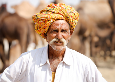 indian fair: PUSHKAR, INDIA - NOVEMBER 21, 2012: Portrait of a Rajasthani Indian man attends the Pushkar fair (Pushkar Camel Fair, Pushkar Mela). Farmers and traders from all over Rajasthan flock for annual fair.